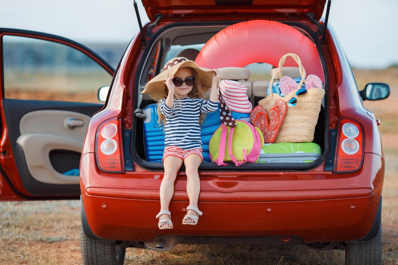 Mädchen im Kofferraum Bauherrenhaftpflicht Auslandsreisekrankenversicherung Christian Willmann Versicherungsmakler Mannheim