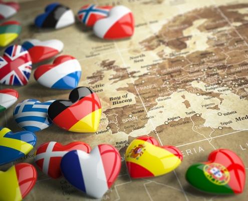 Map of Europe and hearts with flags of european countries. Auslandsschadenschutz KFZ Wohnmobil Christian Willmann Versicherungsmakler Mannheim